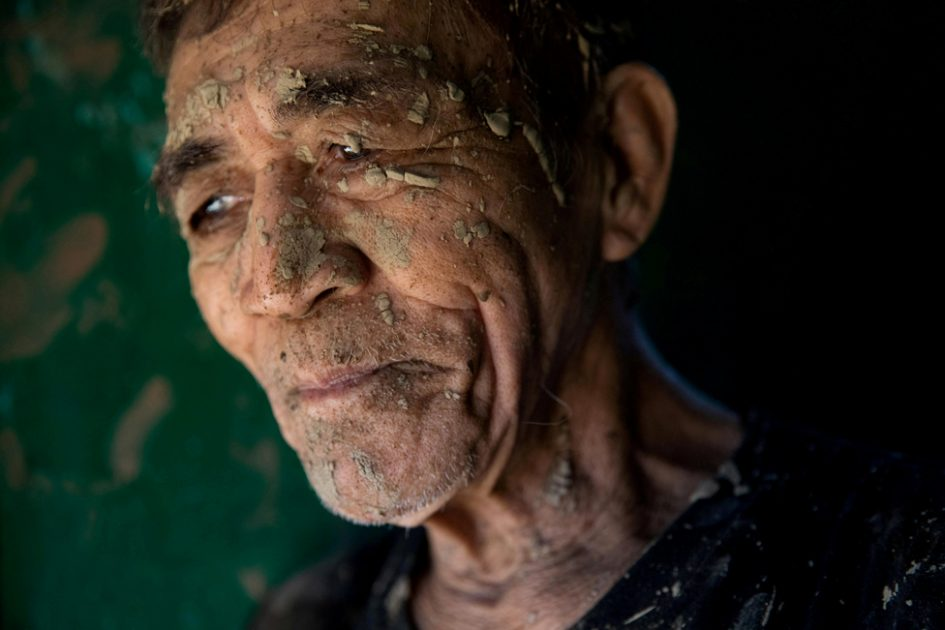 A man covered in mud in San Mateo, Rizal province, Philippines, 13 November 2020