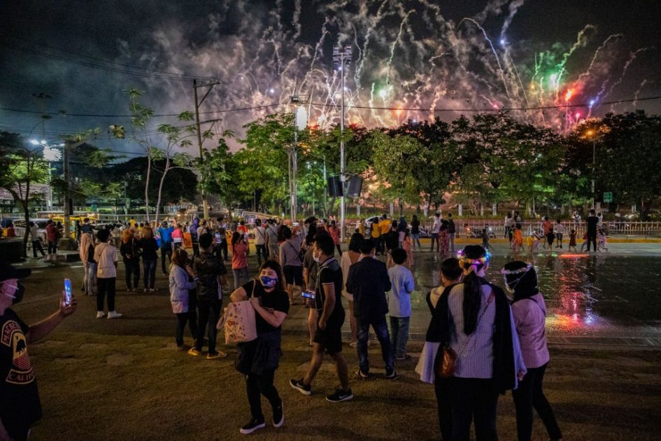 People gather in Manila to watch a fireworks display from a park