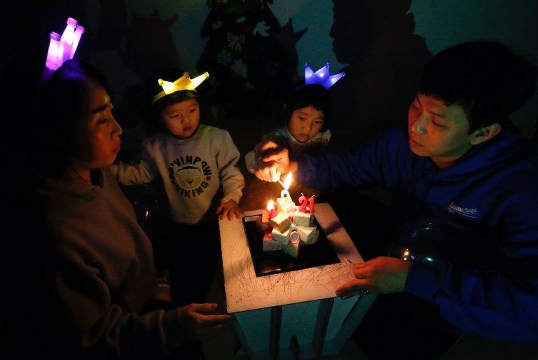 One family in Seoul lit a candle and shared a cake to start 2021