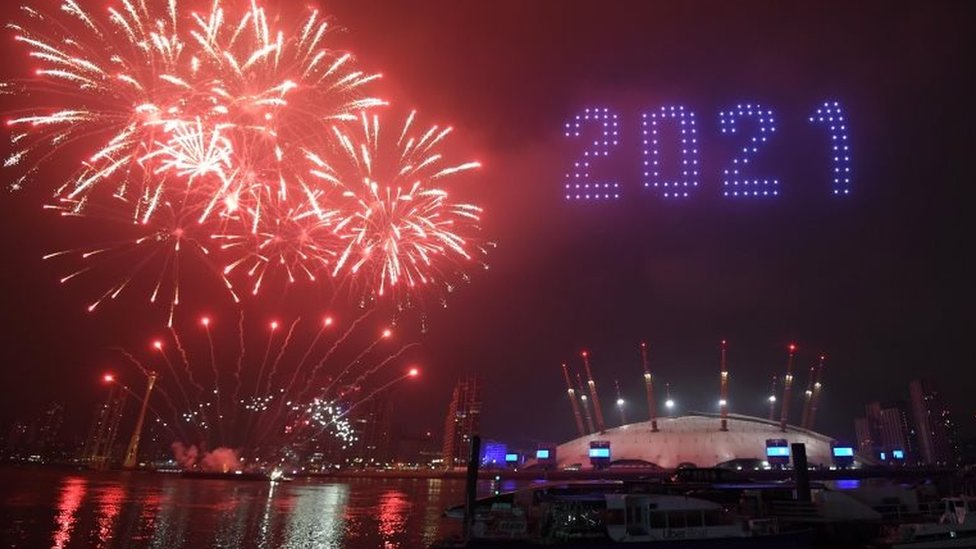 Fireworks and drones illuminate the sky in London