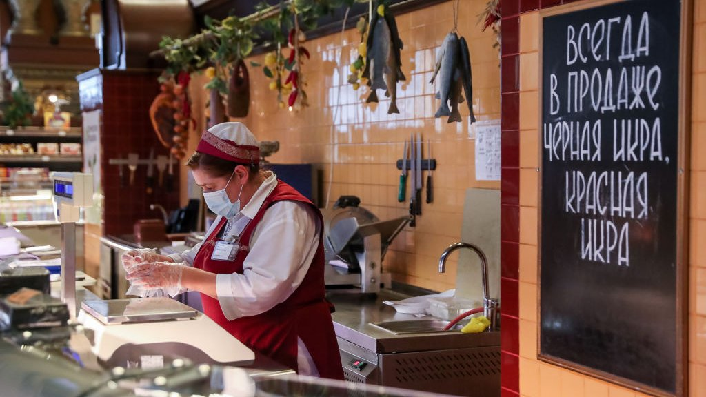 MOSCOW, RUSSIA - NOVEMBER 25, 2020: A woman works at the Yeliseyevsky grocery store in Tverskaya Street, central Moscow