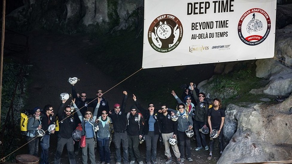 Volunteers leave the Lombrives cave