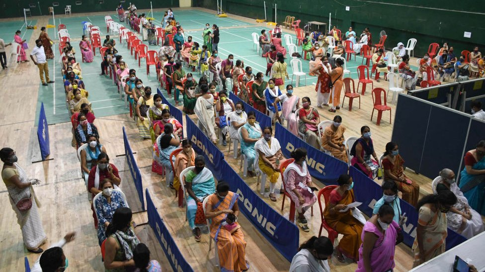 Women in queue to get vaccine against Covid-19 coronavirus in a community vaccination drive by Assam Pradesh Mahila Marcha at an indoor stadium in Guwahati, India.