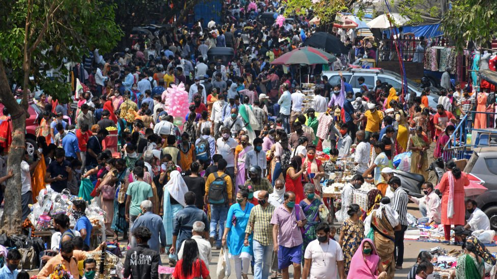 Crowds of people are seen shopping during a weekly market at Kandivali (a suburb in North-West of Mumbai)