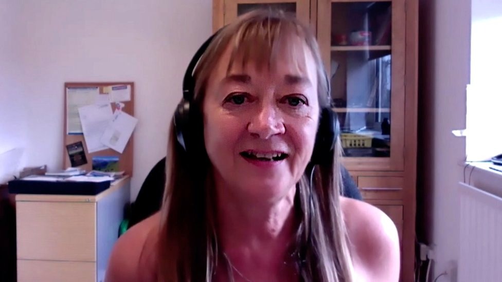 British naturist Donna Price at home doing a Zoom interview with the BBC