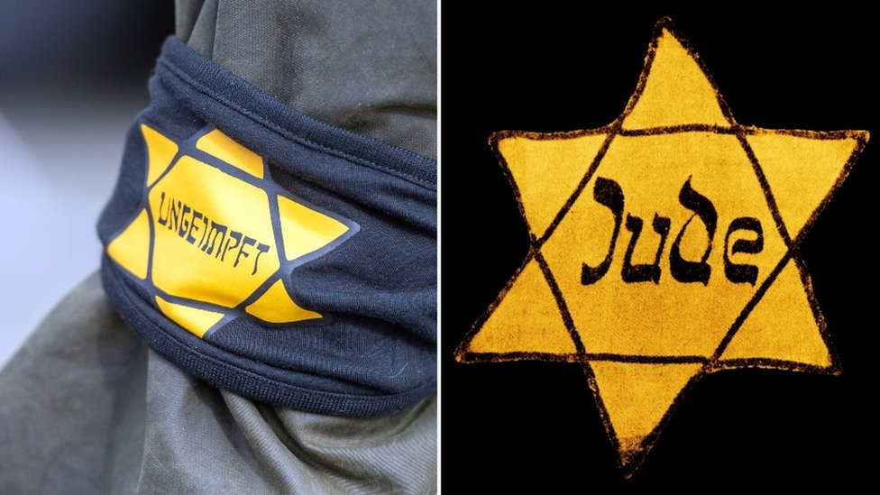 """A Berlin protester wore a yellow star with the word """"unvaccinated"""", mimicking the notorious badges the Nazis forced to wear in World War Two"""